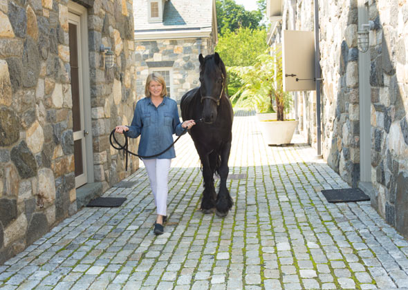Martha Stewart walks her horse