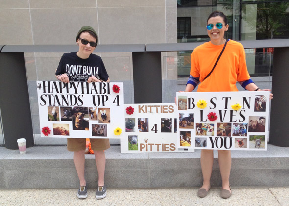 Katie Callahan and Jax Stewart of Boston, Massachusetts show off the signs they made for the One Million Pibble March.