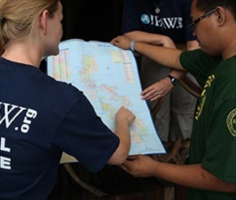 Rescuers work together to assess the situation in the Philippines.