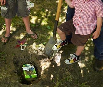 Kids burying pet