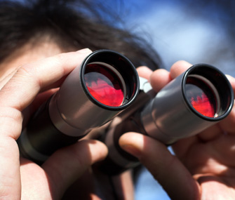 Birdwatcher looking through binoculars