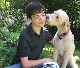 Evan Moss gets a sweet kiss from his service dog and best friend, Mindy.