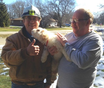 Job, a rescued blind and deaf dog, helped his neighbors by detecting a gas leak. He's pictured here with gas fitter John Albrecht, left, his owner, James Denmore.