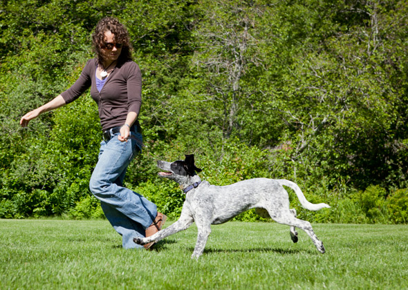 Woman Playing Chase with Dog