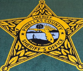 "A rug at a Florida sheriff's office that was misprinted with ""In Dog We Trust"" is being auctioned for the benefit of an animal rescue."