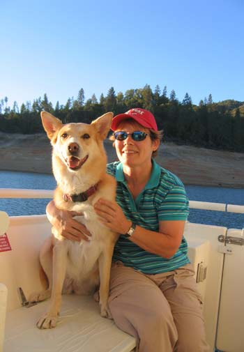 Arden Moore and dog on boat