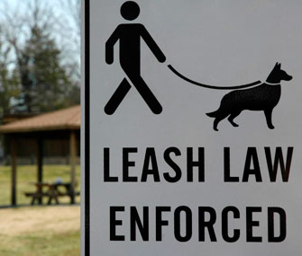 Leash law enforced sign