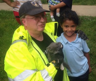 Lancaster Township Fire Department's Deputy Chief Usdin and Janeysha pose with the kitten they saved.