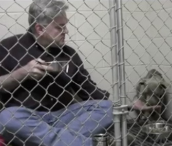 Dr. Andy Mathis climbed into Graycie's cage to comfort her and encourage her to eat breakfast.
