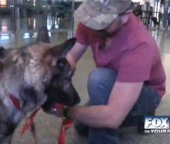 Army Specialist Vance McFarland was reunited with his partner K9 Ikar after three years apart at the Boise airport.