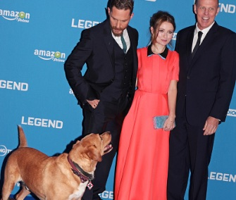 "British actor Tom Hardy's dog Woody poses with him and his costars at the premiere of his movie ""Legend"" in London."