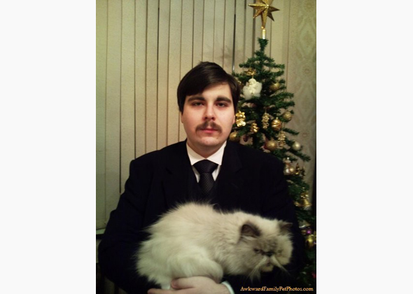 Mustached man and cat
