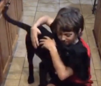 Josh Breaux plays with his 2 1/12-month-old puppy, Drake.