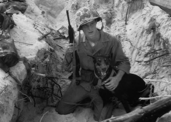 Marine Corporal William Scott, and his Doberman Pinscher, Prince during World War II