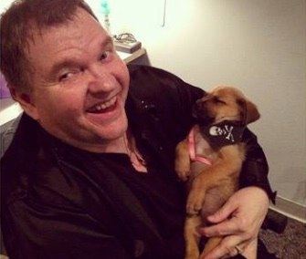 An abandoned puppy left behind a dumpster was rescued by Meat Loaf's crew and named Little Ms. Karma.