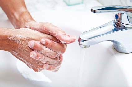 Man washing hands with soapy water
