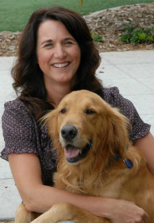This is a photo of Dr. Brenda Phillips, a veterinary oncologist, with her dog, Leo