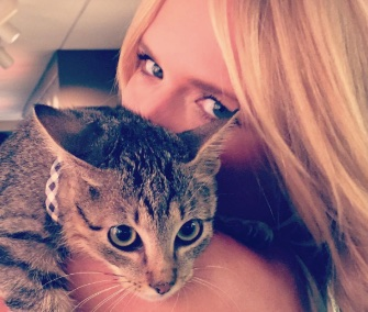 Country star Miranda Lambert snuggles a kitten her friend saved from the side of a highway in Arkansas.