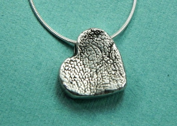 heart shaped pendant with paw print