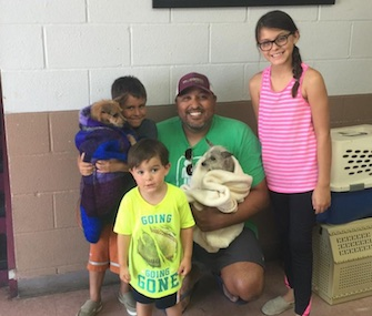 The Montez family was happy to be reunited with Corky, left, and to add Captain, right, to their household.