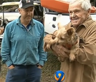 George Osterhues, right, and his dog, Tila, were rescued from their sinking car in the South Carolina floods by Tom Hall, left, and his family.