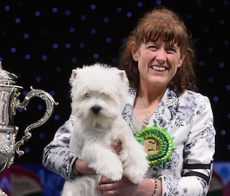 Breeder and handler Marie Burns holds Geordie Girl after her Best in Show win at Crufts.