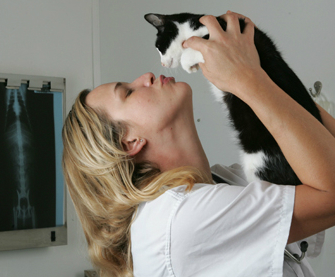 Dr. Patty Khuly holding her cat