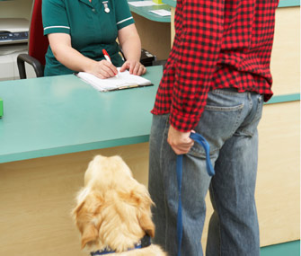 Man at veterinary clinic with his dog