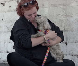 Annie Hart gets kisses from a thankful Layla during her rescue on a Los Angeles street.