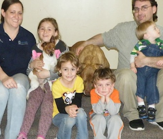 Hercules, a Pit Bull-Lab mix, and his blind friend Muellas, a Rat Terrier mix, were adopted by an Ohio family.