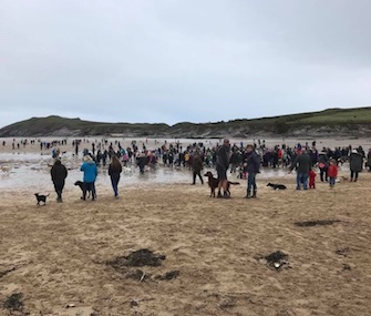 Hundreds of dogs and their owners turned out for Walnut's final walk on the beach in England.