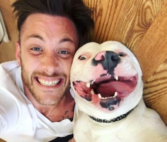 New owner Dan Tillery poses with a grinning Diggy after his adoption this summer.