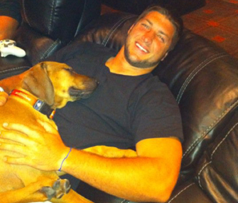 Tim Tebow and Dog