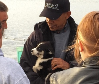 President Barack Obama snuggled with a sled dog puppy on his trip to Alaska this week.