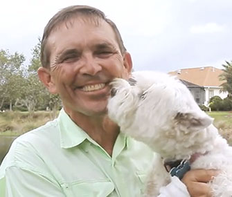 Steve Gustafson with Bounce, the dog he saved from an alligator's clutches.