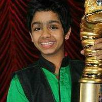 Proud-moment--aditya-singhal-poses-with-his-trophy