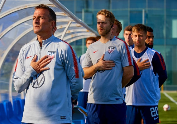 Jason_kreis_and_u-23_staff_during_anthem_-_asn_top_-_isi_-_u-23_sidelines_-_march_2019_-_david_aliaga