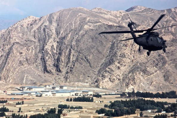 A UH-60 Black Hawk helicopter carrying U.S. leaders and advisers travels to the regional police logistics center in Nangarhar province, Afghanistan, Feb. 17, 2015. The service members are assigned to the Train, Advise, Assist Command East, Resolute Support Mission and Combined Security Transition Command Afghanistan. U.S. Army photo by Capt. Jarrod Morris