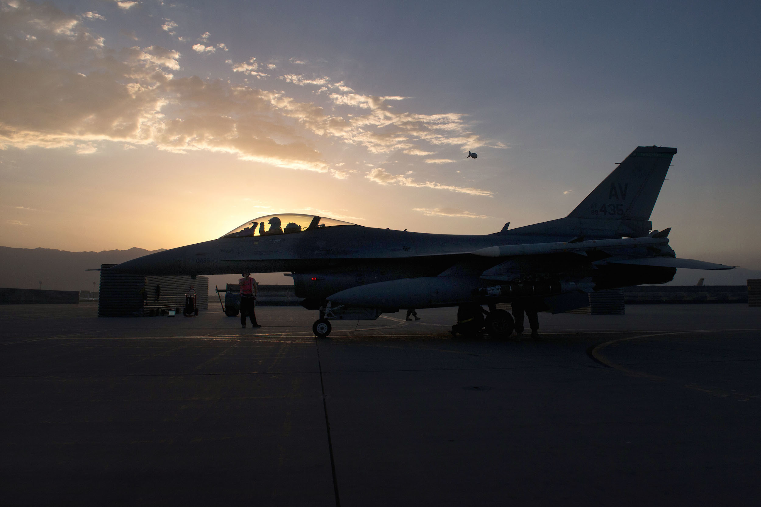 U.S. Airmen from the 455th Expeditionary Aircraft Maintenance Squadron's weapons flight prepare to complete a final check of the weapons on an F-16 Fighting Falcon aircraft before it takes off on a combat sortie from Bagram Air Field, Afghanistan, July 14, 2015. The F-16 is a multi-role fighter aircraft that is highly maneuverable and has proven itself in air-to-air and air-to-ground combat. Members of the Triple Nickel are deployed in support of Operation Freedom's Sentinel and NATO's Resolute Support mission. (U.S. Air Force photo by Tech. Sgt. Joseph Swafford/Released)