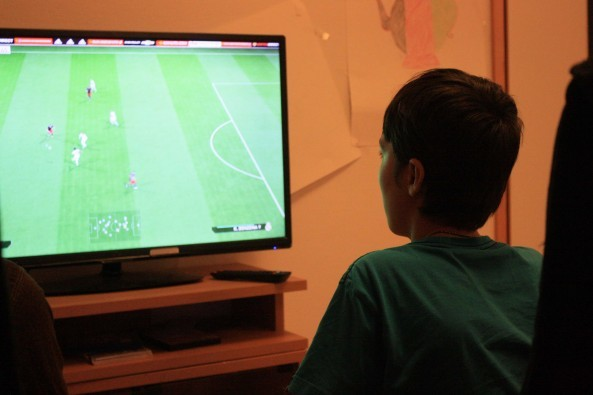 Hamid, 12, playing a football game in Malmo, Sweden