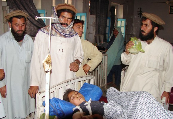Pakistani tribesmen with a boy injured in a US drone attack May 22 2010 - GettyImages