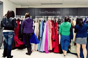 Young Ladies picking out their dresses for prom
