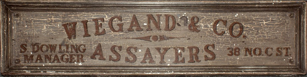 Lot 2231 - Iconic Comstock Assayer, Original Wiegand & Company Sign