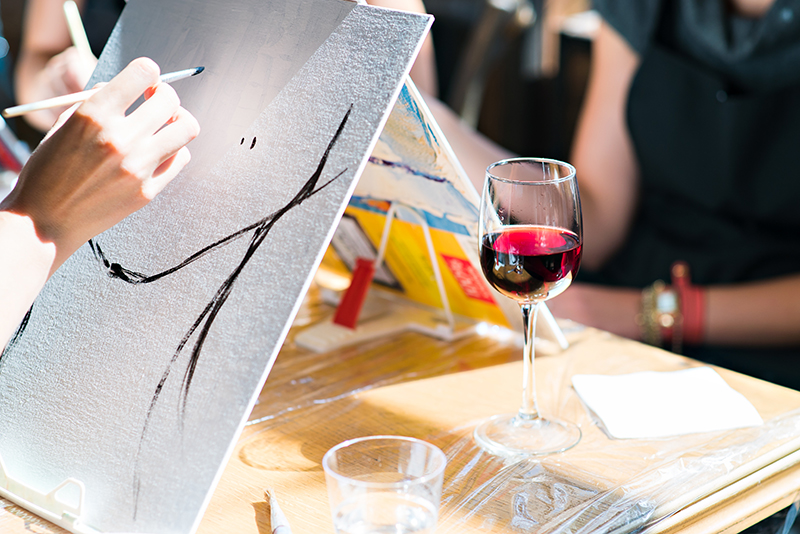 Drawing a glass of red wine on a table