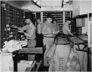 Clerks sorting mail on a Railway Mail Service train