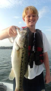 John Love, ten year old fifth grader from Charlotte, NC is holding a trophy spotted bass he caught on a recent Lake Norman fishing trip with his Dad, Barry and brother, Ryan. <br><br>Photo courtesy of Capt. Gus Gustafson<br><br> <br><br>