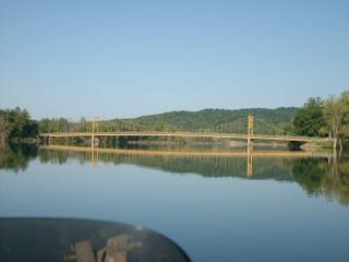 The Swinging Bridge at Beaver town on the Arkansas side of Table Rock. Outside of Eureka Springs near Holiday Island. Before going up the White River. Also known as the Beaver Tail waters. 8 miles from Beaver Dam.