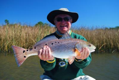 Robinson Brothers Guide Service <br>877-6-REDFISH <br>www.floridaredfish.com