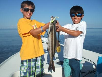 Logan (L) with Alex Meeks (R) and their first ever cobia, caught on a CAL Jig with a shad tail while fishing lower Tampa Bay with Capt. Ray Markham aboard the Flat Back II out of Terra Ceia.<br> <br>