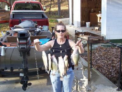 more nice crappie and a striper caught by Naomi